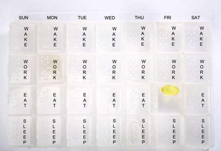 Pill box with one pill 版權商用圖片