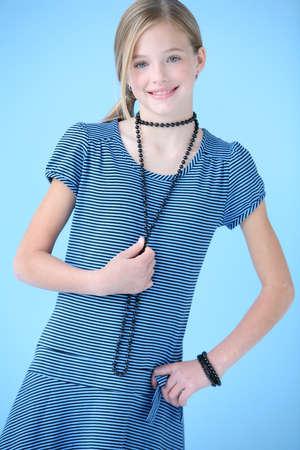 Meisje in blauwe jurk  Stockfoto