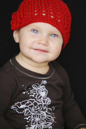 colleen: Baby in red hat Stock Photo