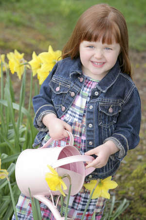 Little girl watering flowers Stock Photo - 7209971