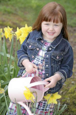 Little girl watering flowers Stock Photo - 7209971
