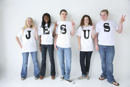 christian faith: Five teenagers with t-shirts spelling Jesus Stock Photo