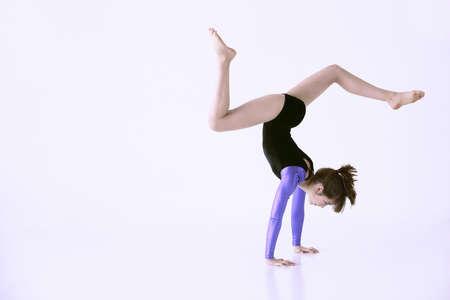 Girl doing gymnastics photo