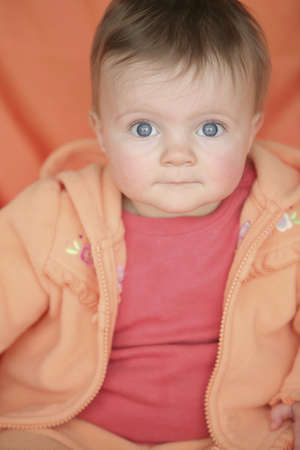 cahill: Baby in orange jacket