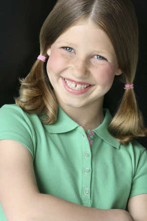 colleen: Young girl with pigtails in green polo shirt Stock Photo