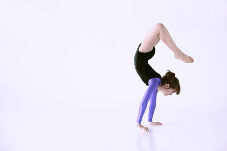 cahill: Girl doing handstand