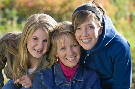Portrait of mother with two teenage daughters photo