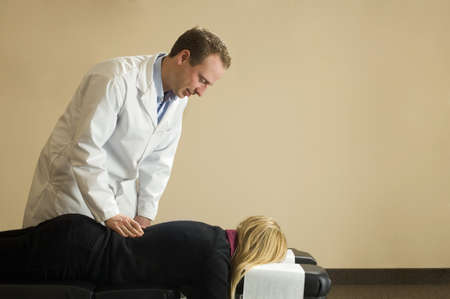 fortysomething: Chiropractor with his patient