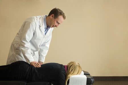 chiropractor: Chiropractor with his patient