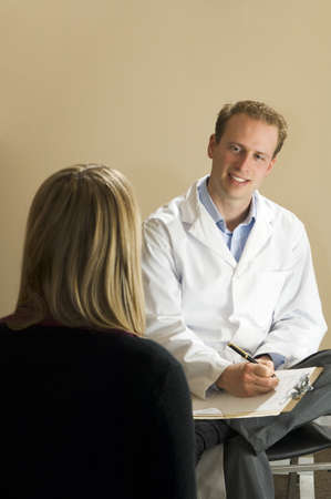 30 something: Chiropractor with his patient