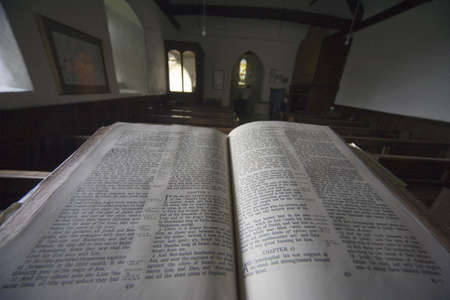 house of worship: Old bible in church,North Yorkshire,England,Europe Editorial