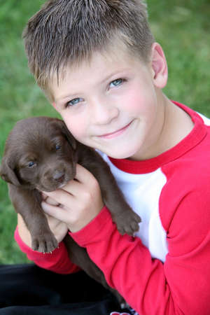 eyecontact: Boy holding puppy