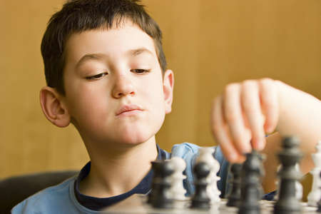 Boy playing chess Stock Photo - 7551632