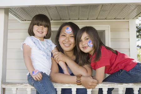 two and a half: Mother with girls displaying national pride