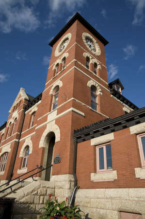 historical buildings: Lake of the Woods, Kenora, Ontario, Canada; Clock tower above brick city hall building