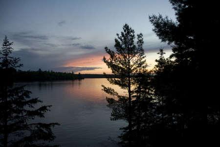 Lake of the Woods, Ontario, Canada; Majestic sunset over placid lake Stock Photo - 7551591