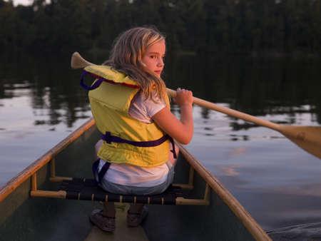 canoe paddle: Girl in canoe LANG_EVOIMAGES