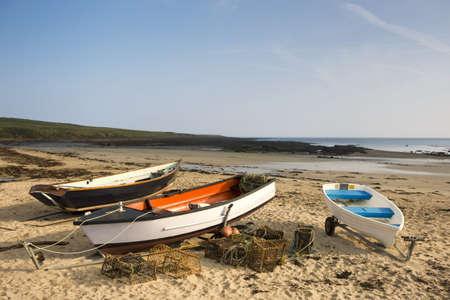 rowboats: Empty boats on beach, Northumberland, England