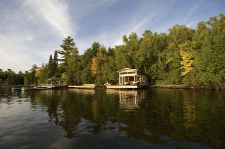 Cottage on lake, Lake of the Woods, Ontario, Canada Stock Photo - 7551731