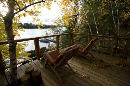 lakeshores: Cottage deck and autumn foliage, Lake of the Woods, Ontario, Canada