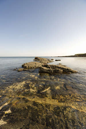 Rocks in shallow water by the shore Stock Photo - 7559204