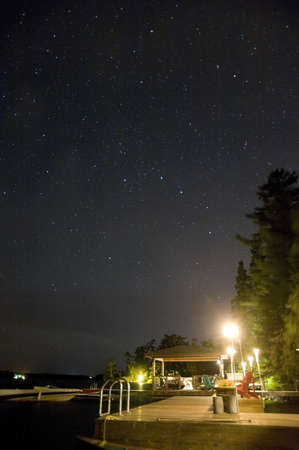 Cottage dock lit up at night, Lake of the Woods, Ontario, Canada Stock Photo - 7551870