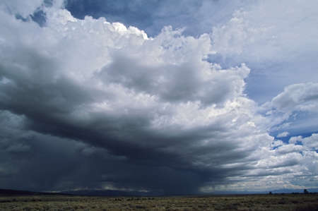 dark cloud: Massive storm front forming over the plains