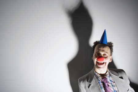Man wearing a clowns nose and hat
