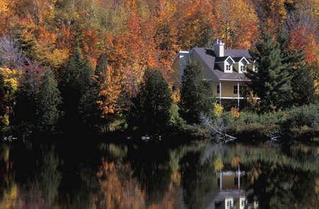 秋の湖の家 写真素材