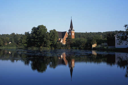 Countryside and church reflected in the lake Stock Photo - 7559220
