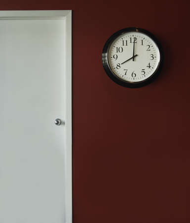 indoors: A wall clock showing 8 oclock