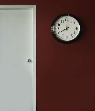 A wall clock showing 8 o'clock Foto de archivo