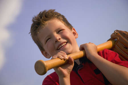 catcher's mitt: Smiling boy with a baseball bat