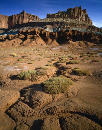 Barren landscape, rugged butte called