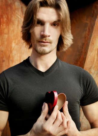 Man Opening his heart Stock fotó