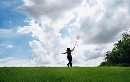 Woman in field with butterfly net Stock Photo - 7551546