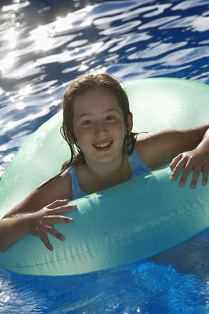 Young girl playing in water inside tube Stock Photo - 7551567