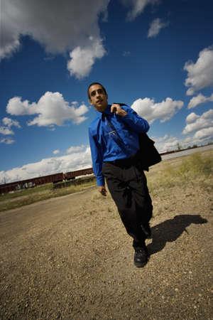 railroad tie: Man walking near railroad tracks