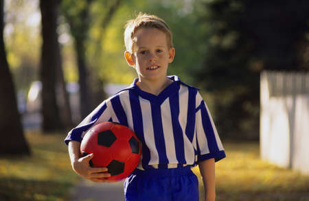 Boy carrying soccer ball