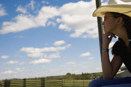 Girl on farm wearing cowboy hat Stock Photo - 7551573