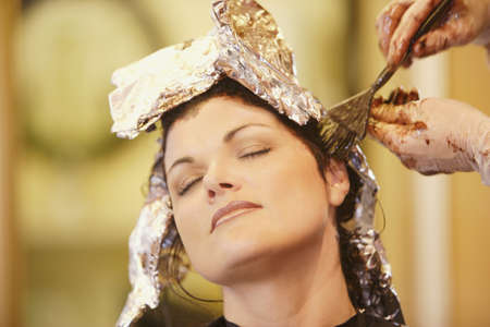 Woman having her hair dyed Stock Photo - 7551654