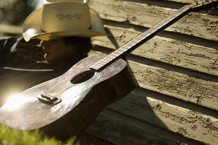 Cowboy and his guitar Фото со стока
