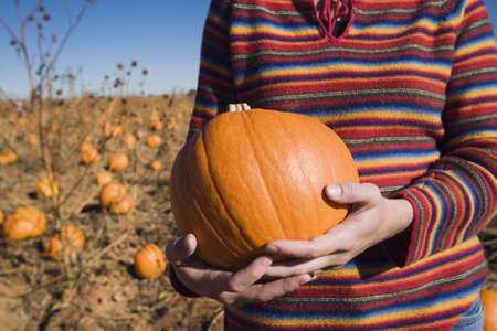 raniszewski: Woman holding a pumpkin
