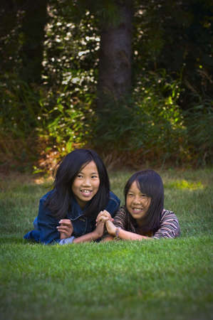 Sisters holding hands Stock Photo - 7551606