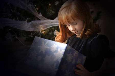 Child looking inside Christmas present Stock Photo - 7551396