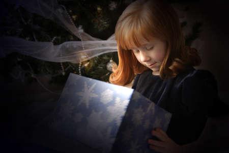 christmas gift: Child looking inside Christmas present