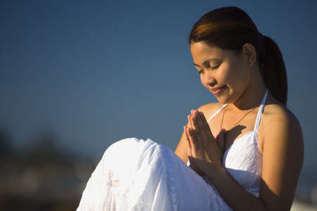 intercessor: A young woman praying