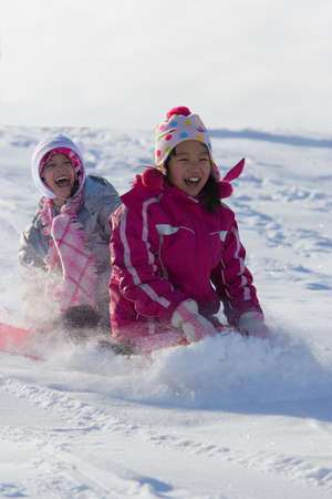 sledding: Children tobogganing