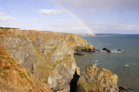Rainbow over The Copper Coast, Near Bunmahon, Co Waterford, Ireland Stock Photo - 7559476