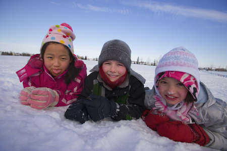 Children playing in the snow Stock Photo - 7559284